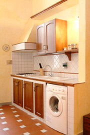 Florence Centre Accommodation: Kitchen with washing machine of Tafi Accommodation in Florence centre