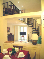 Rome Apartment Rental: Living and dining-room with spiral staircase of Tritone Type D Rental Apartment in Rome