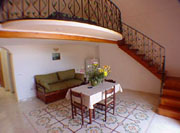 Dwelling in Positano: The living-room with the mezzanine floor of Ludovica Type C Dwelling in Positano