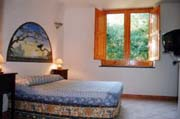Lodging in Positano: Example of a bedroom of the Vicalvano Type C Lodging in Positano
